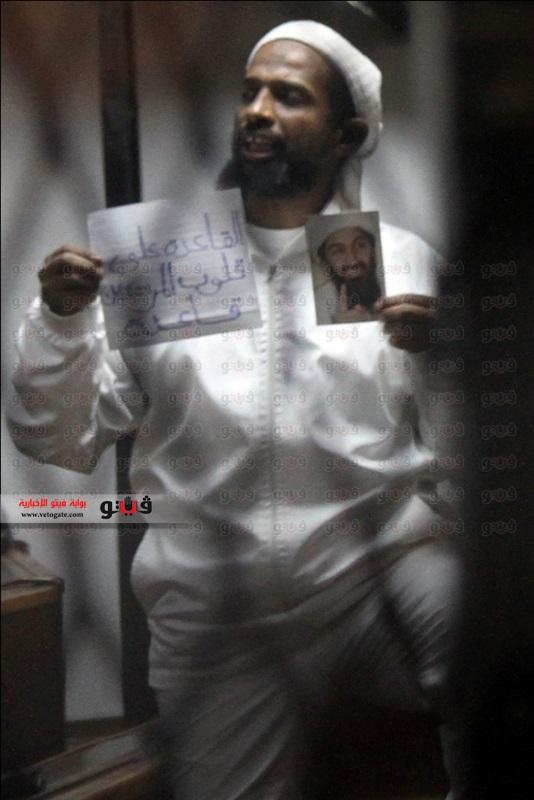 Jamal holding photo of bin Laden.jpg