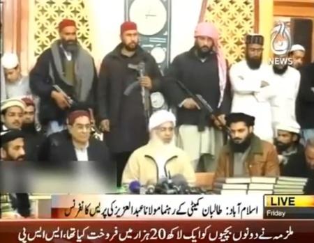 Abdullah-Aziz-armed-bodyguards.jpg