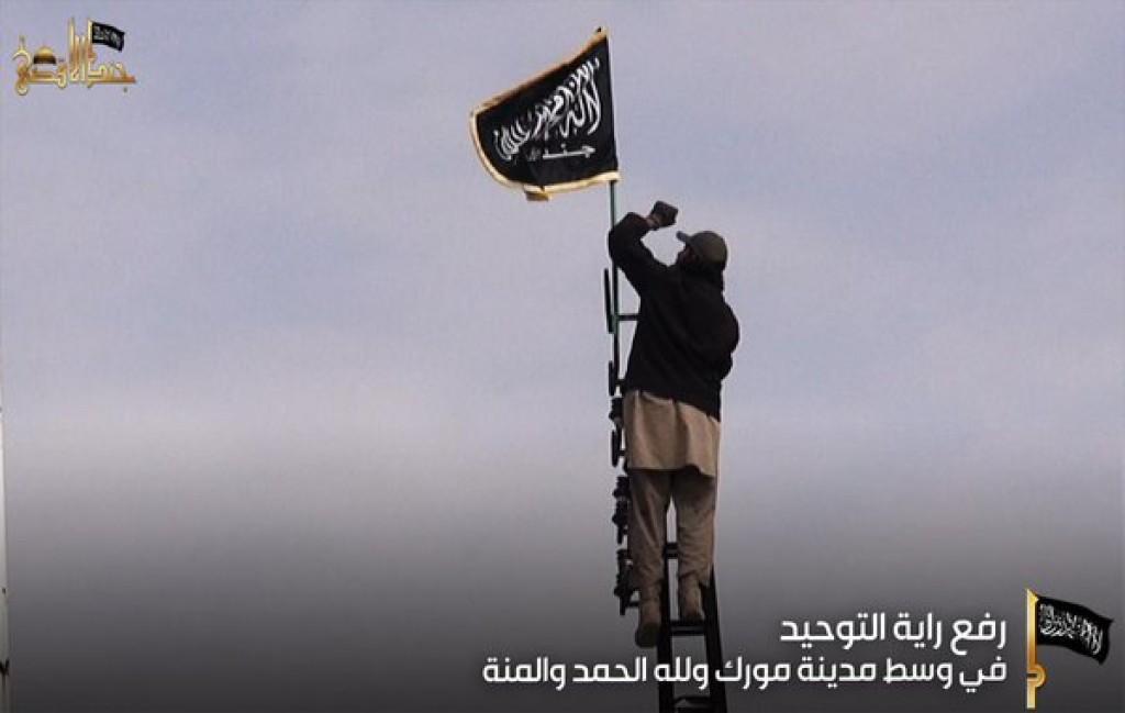 15-11-05 Jund al Aqsa rasises banner in Morek