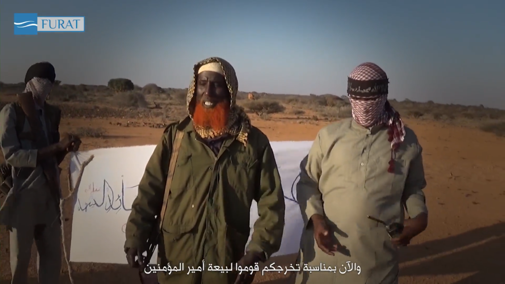 Abdulqadr Mumim, center, with red beard. Image from an Islamic State video showing a training camp in Somalia.