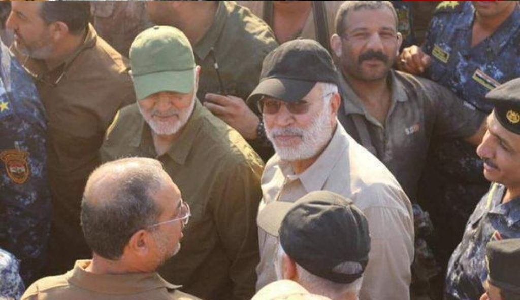 Qods Forces Commander Qassem Soleimani (green hat) and Popular Mobilization Forces operational commander Abu Mahdi al Muhandis (black hat).
