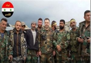 The leader of the Quds Brigade Mohammad Ahmad, middle, with combatants.