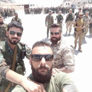 Quds Brigade combatant with Russian officers in the back, posted in June 2016.