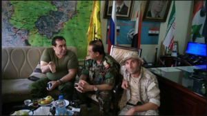 Photo 1. Aleppo operations room, posted by pro-regime account in late Oct. Iranian, Syrian, Russian, Lebanese Hezbollah flags in background.