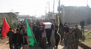 Photo 2. Funeral procession held in Zahraa for two Syrian Shiites killed in Aleppo operation, Dec. 7. Imam al Hujja Regiment flag on left.