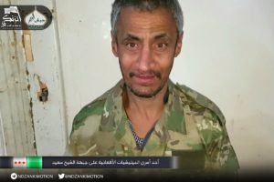 Photo 8. Shiite Afghan fighter taken prisoner in Sheikh Saeed, south Aleppo, by Sunni Islamist group Harakat Nour al Din al Zanki, part of the Islamist-led Jaish Fatah coalition.